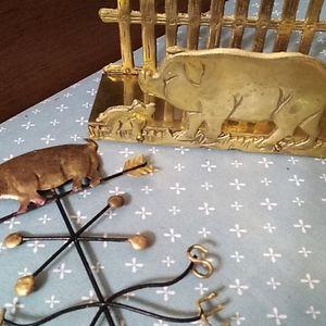 Brass pig letter/napkin holder